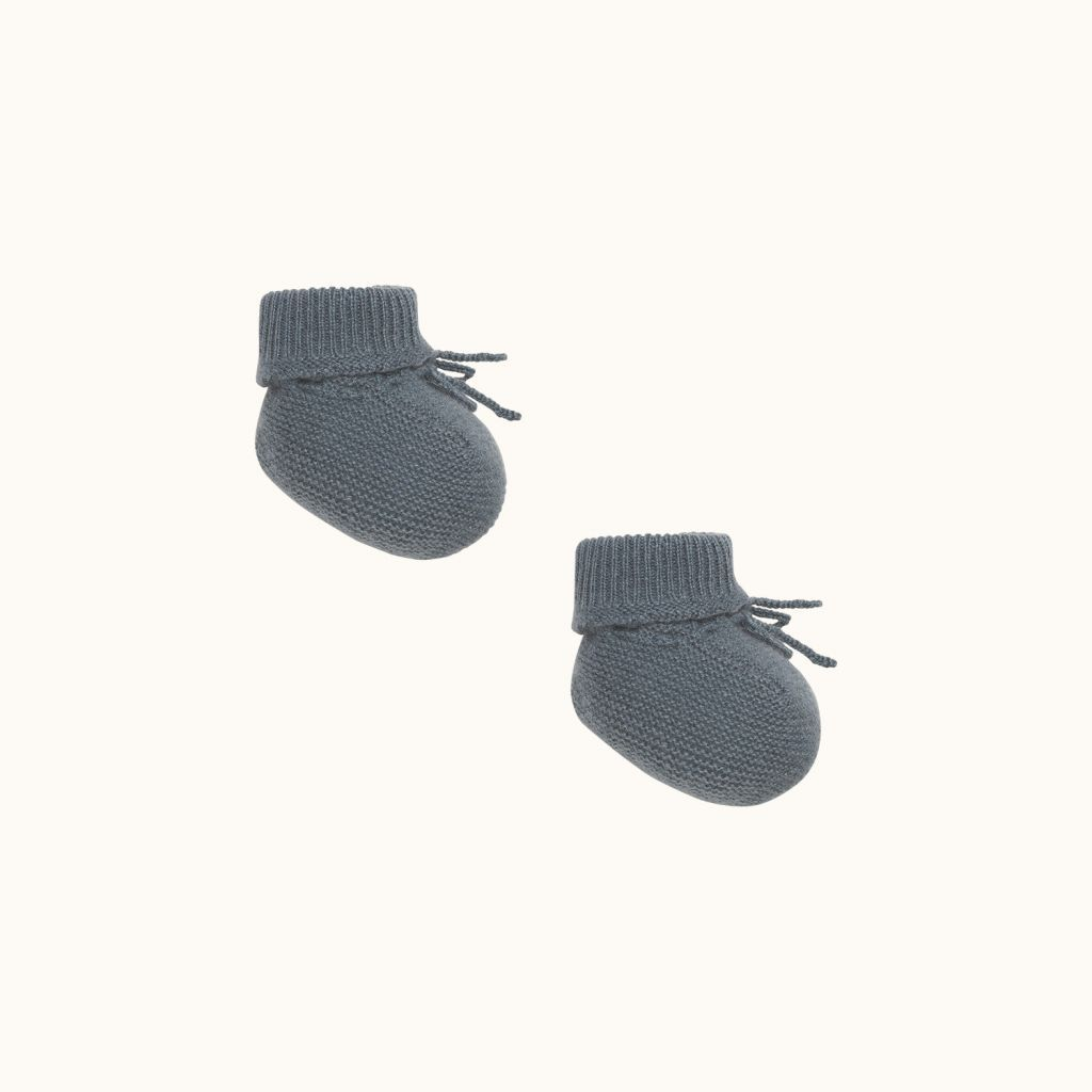 Babies' slippers gray blue background
